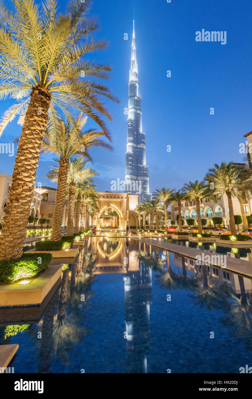 View of Burj Khalifa and Souq al Bahar at night in Downtown Dubai in United Arab Emirates - Stock Image