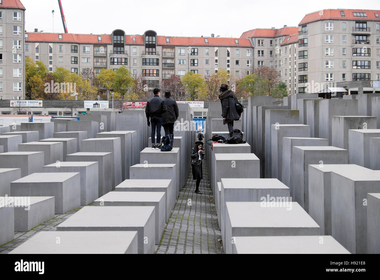 Tourists standing on the Memorial to the Murdered Jews of Europe in Berlin, Germany, Europe, EU   KATHY DEWITT - Stock Image