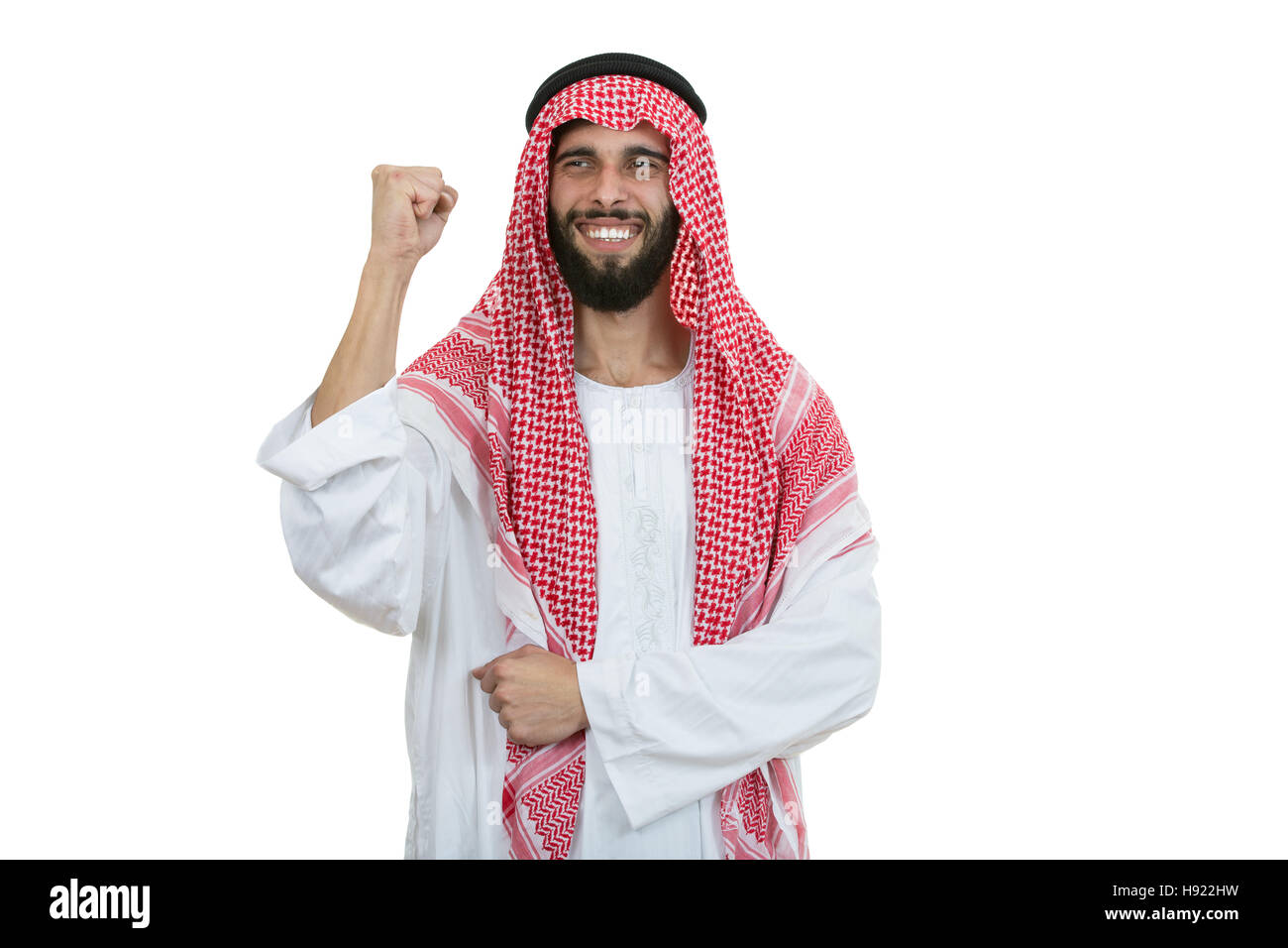 An arab person with a thumbs up isolated on white background - Stock Image