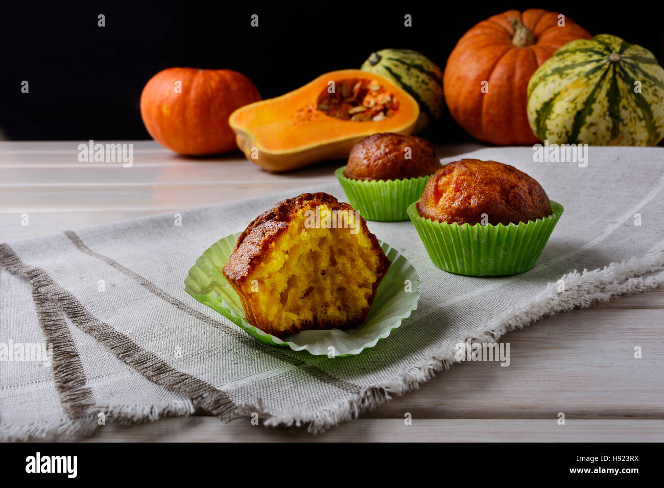 Spiced butternut squash muffins in the green wrappers. Fall seasonal vegetable food. Thanksgiving homemade sweet Stock Photo