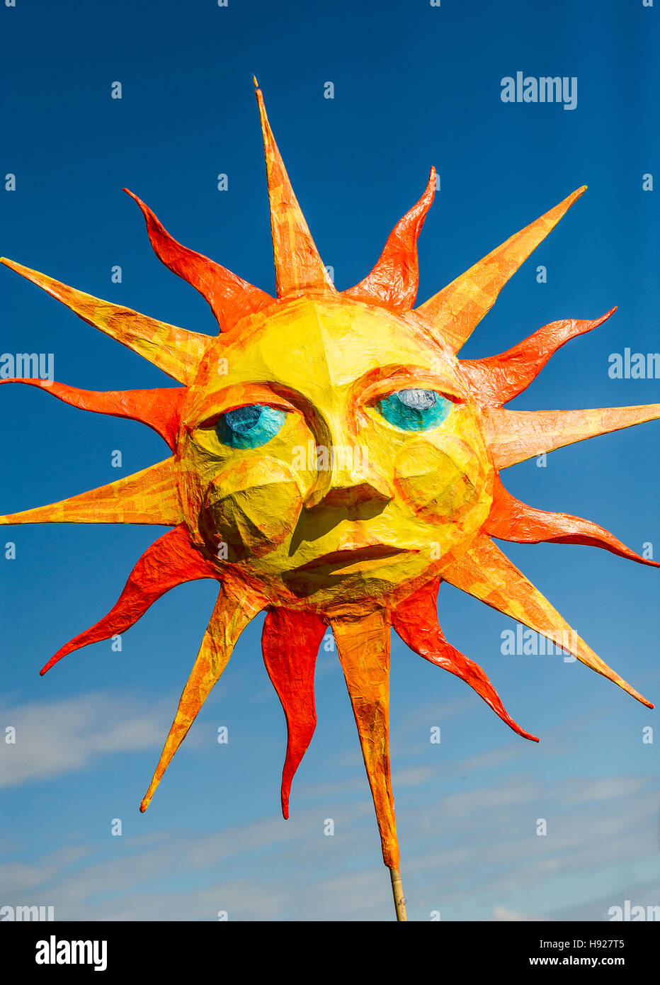 A papier mache representation of the sun in the Penryn Festival in Cornwall. - Stock Image