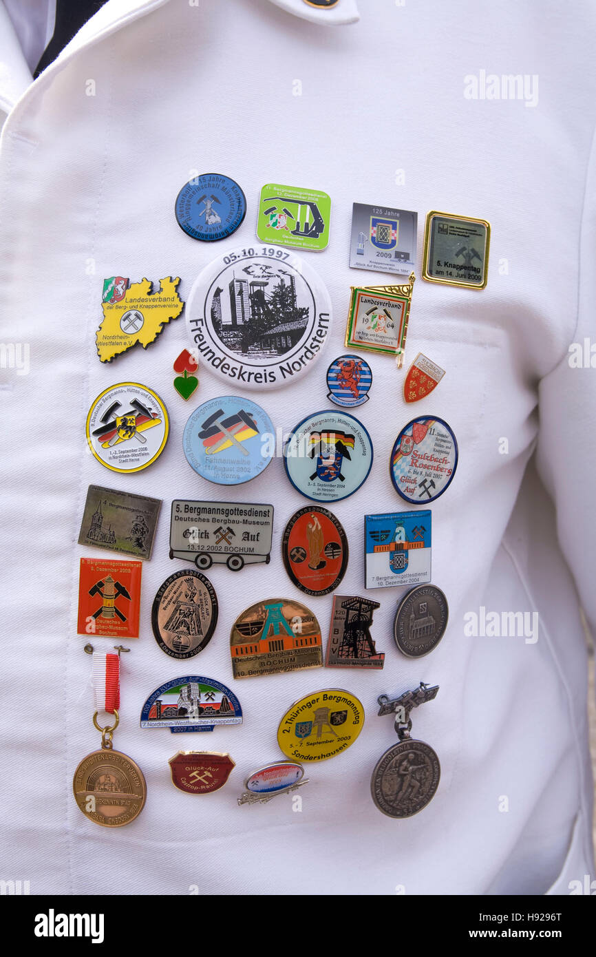 Germany,  Ruhr area, Witten, pins on the work clothes of a miner at the miners day at the former coal mine Nachtigall. - Stock Image