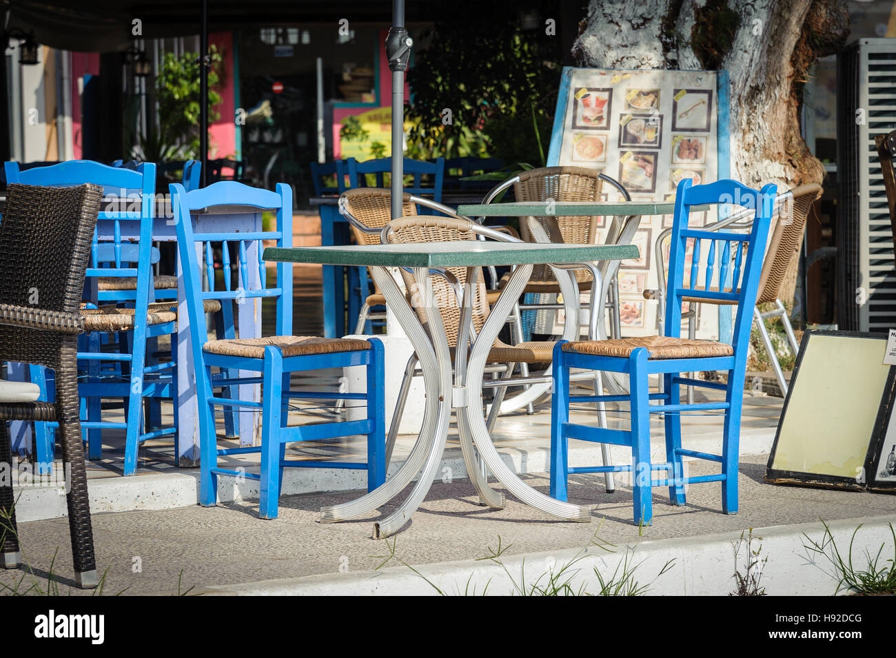 Blue Wooden Chairs And Table At Traditional Greek Tavern   Stock Image