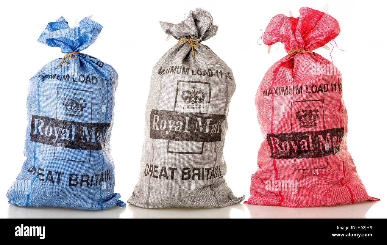 Three Royal mail sacks - Blue, Grey and Red - Stock Image