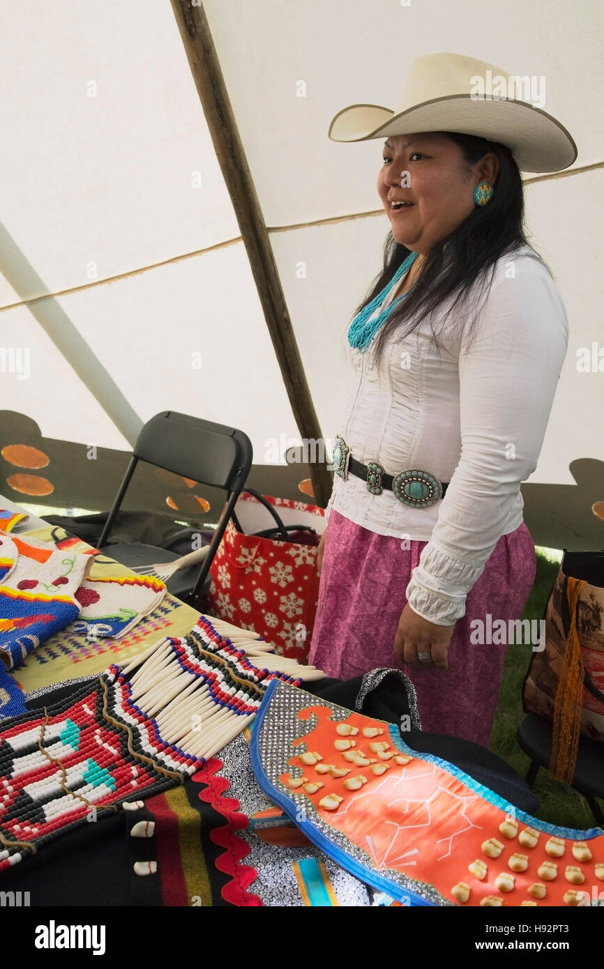 Woman in tipi with educational display of First Nations garments on Canada Day - Stock Image