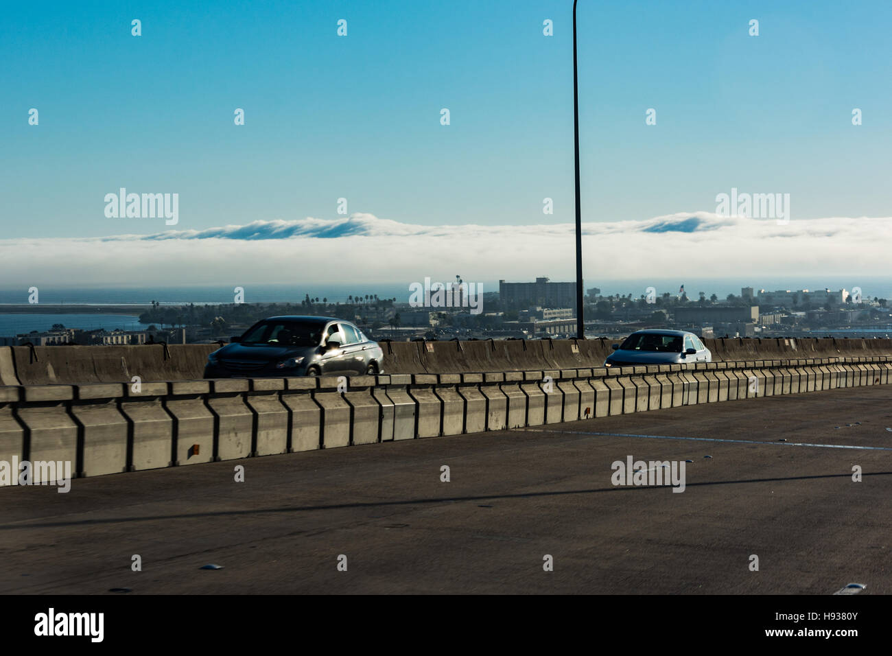 A cloud layer right on top of the City of Coronado,California - Stock Image