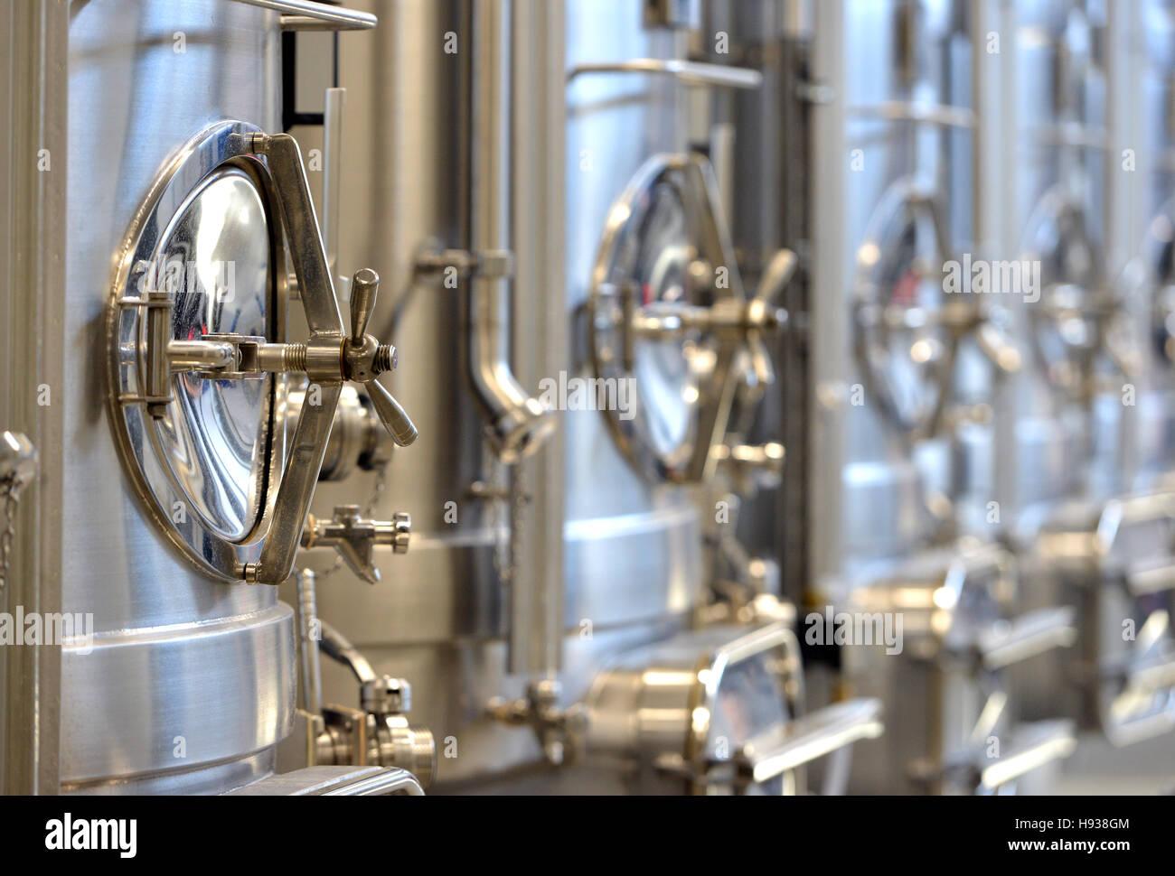 Stainless steel wine making stills - Stock Image