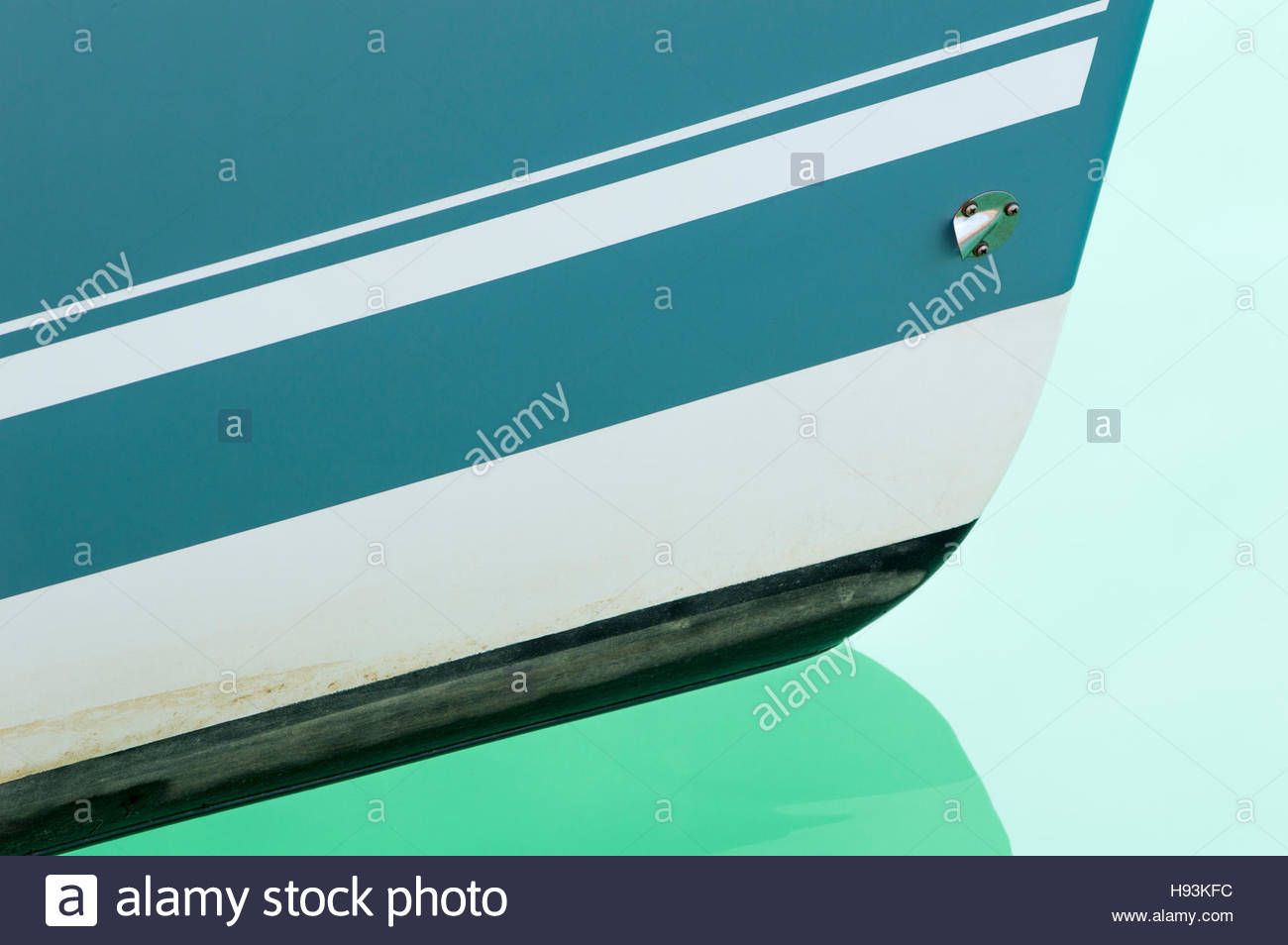 Close-up of the prow and its reflection in the clear waters of Weymouth Marina, Dorset, England - Stock Image