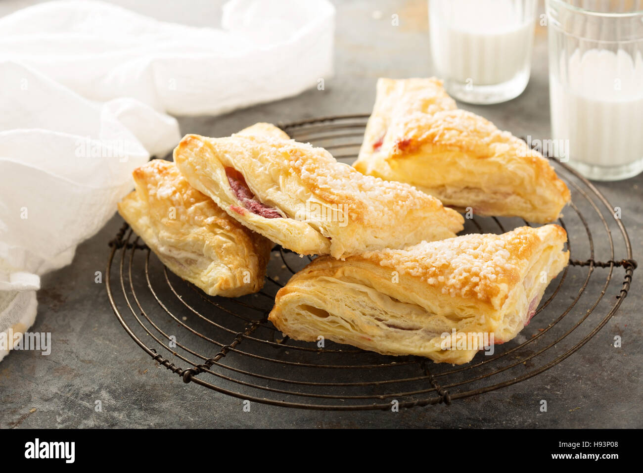 Puff pastry with cherry filling - Stock Image