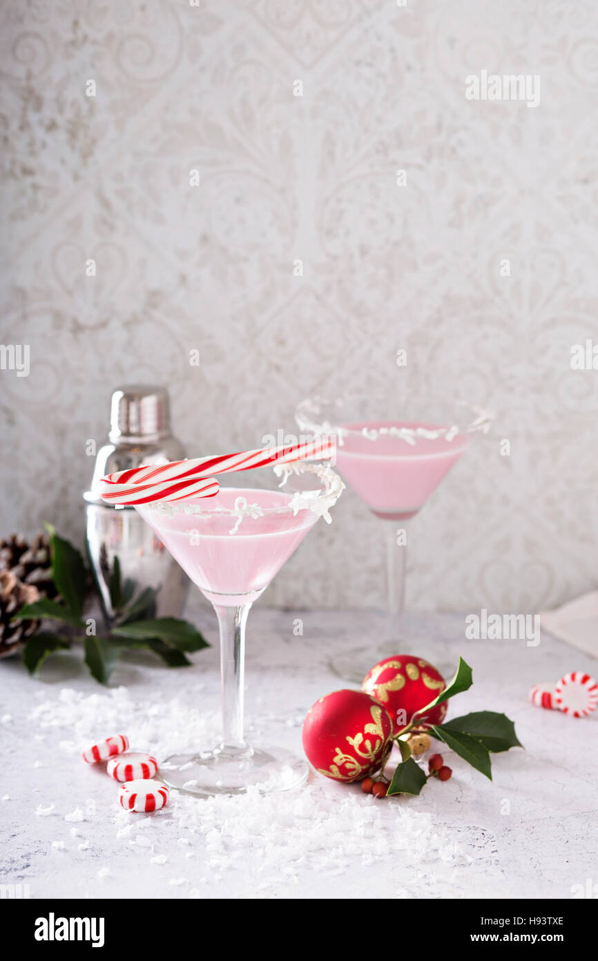 Peppermint martini cocktail with coconut flakes rim - Stock Image