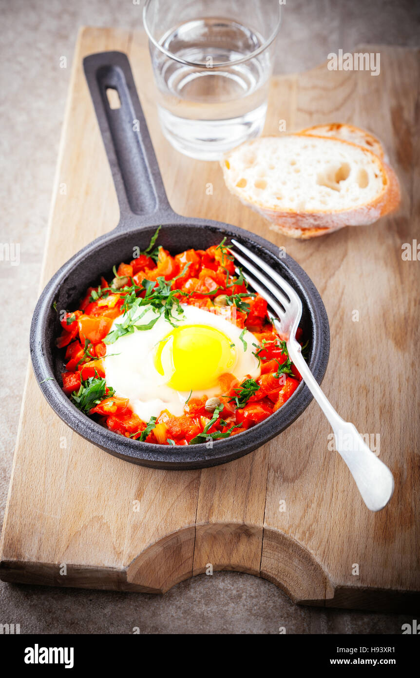 Traditional middle eastern dish of shakshuka in a pan. - Stock Image