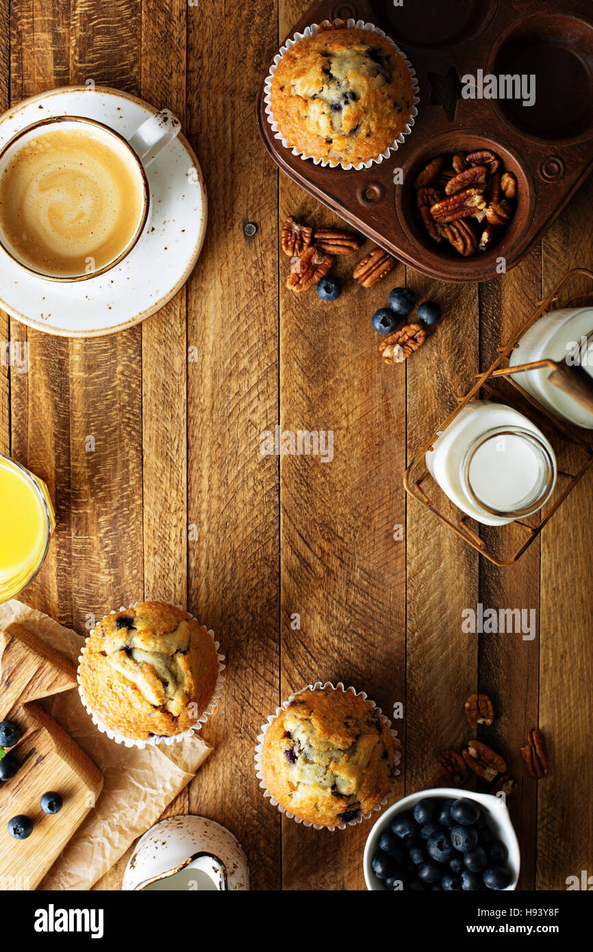Freshly baked blueberry muffins in a rustic setting - Stock Image
