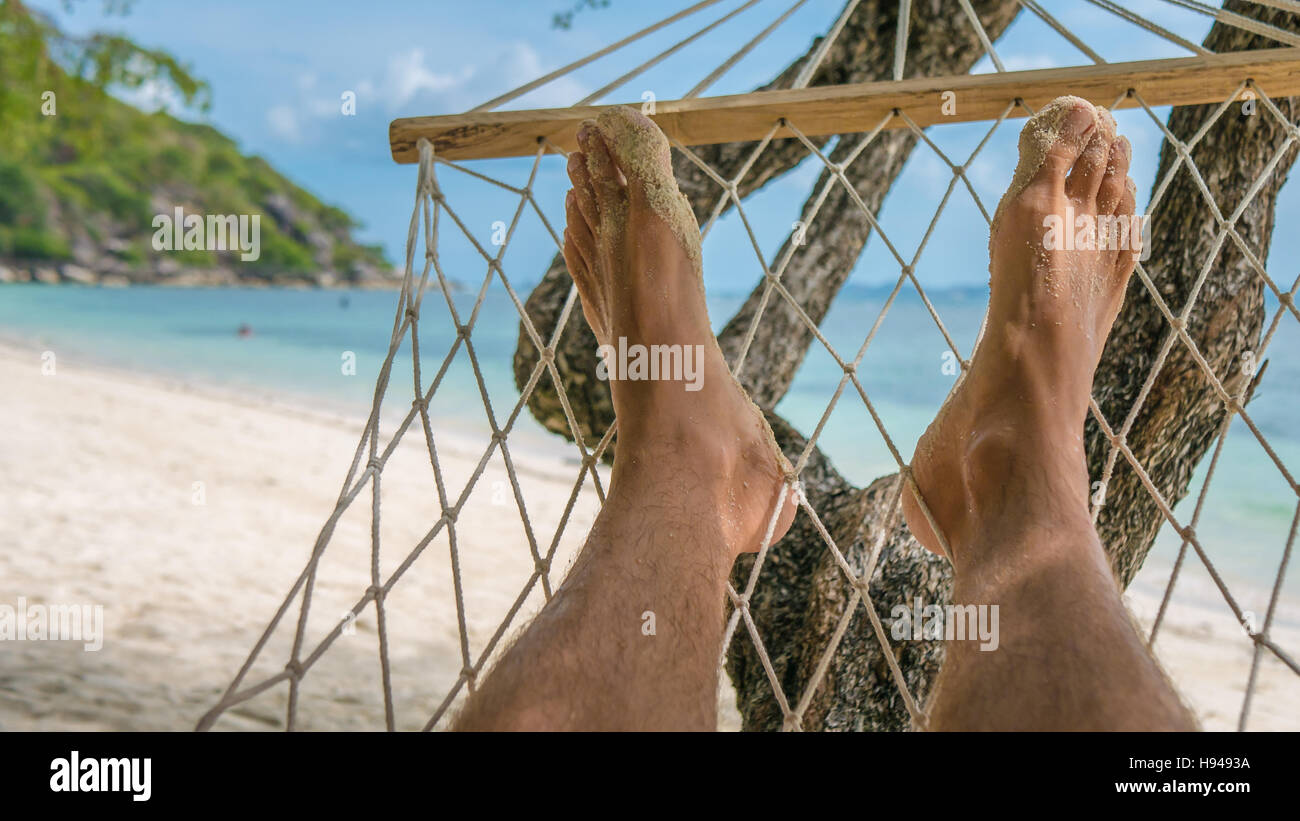 Relax on the Beach in Hammock, Haad Rin , Koh Pangang - Stock Image