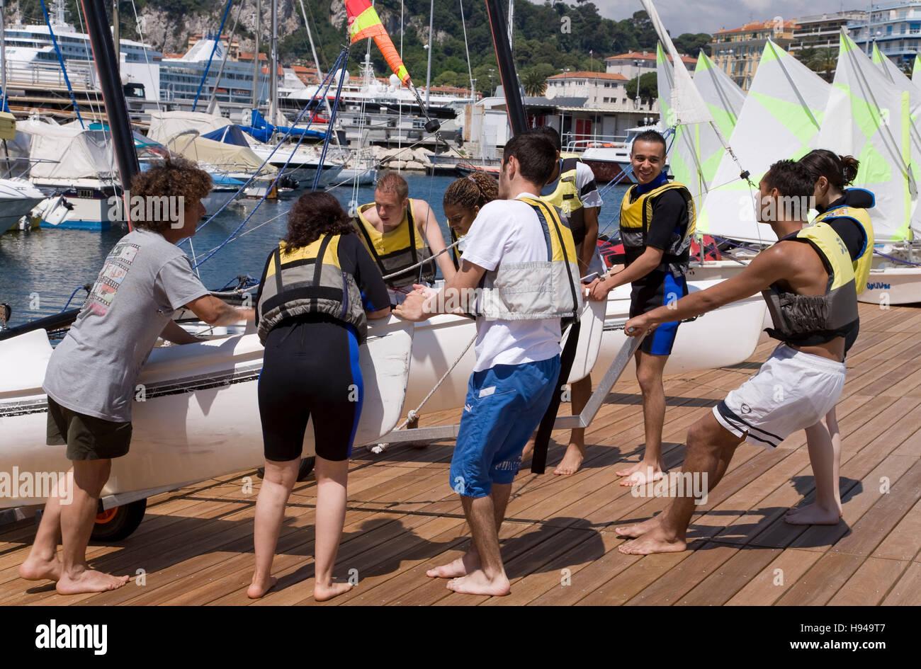 Club Nautique De Nice teenagers with a catamaran at the club nautique, sailboat