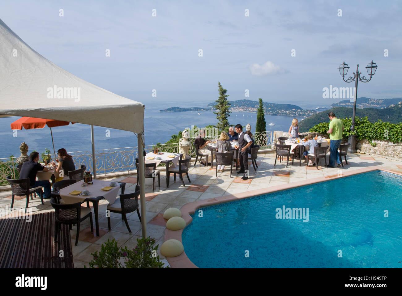 Hotel restaurant Chateau de la Chèvre d'Or, pool, terrasse, view on to Cap Ferrat, Èze-Village, Èze, - Stock Image