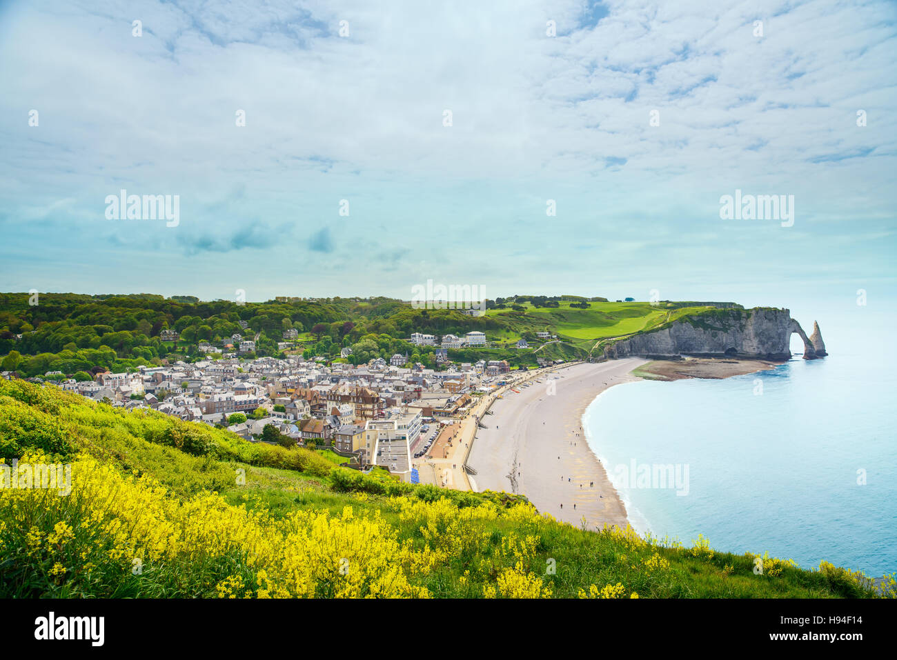 Etretat village, beach and Aval cliff landmark on ocean. Aerial view. Normandy, France, Europe. - Stock Image