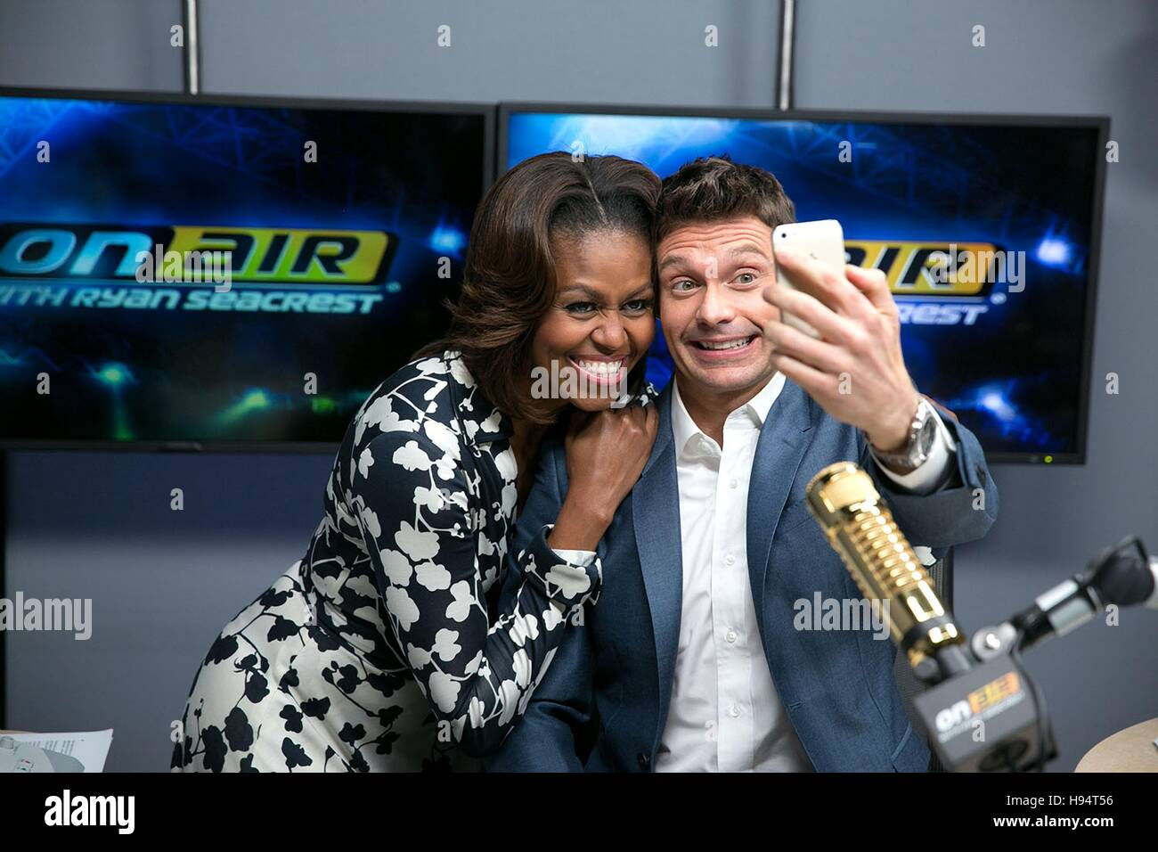 U.S. First Lady Michelle Obama poses for a selfie with television host Ryan Seacrest after taping a Lets Move interview - Stock Image