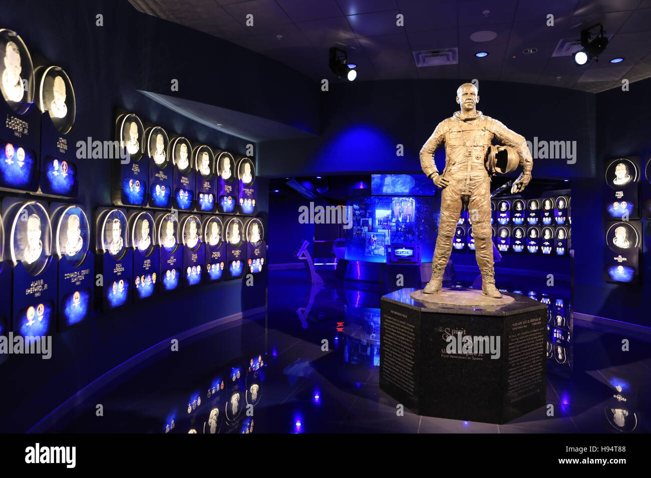 A statue of NASA astronaut Alan Shepard at the Heroes and Legends attraction stands inside the doors to the U.S. - Stock Image