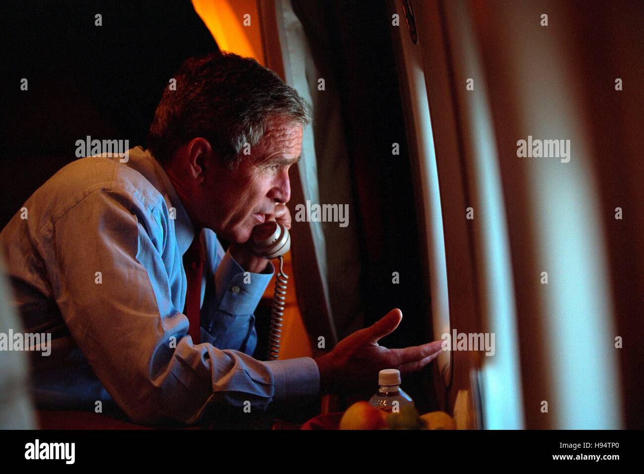 U.S. President George W. Bush talks on the phone aboard Air Force One September 11, 2001. Stock Photo