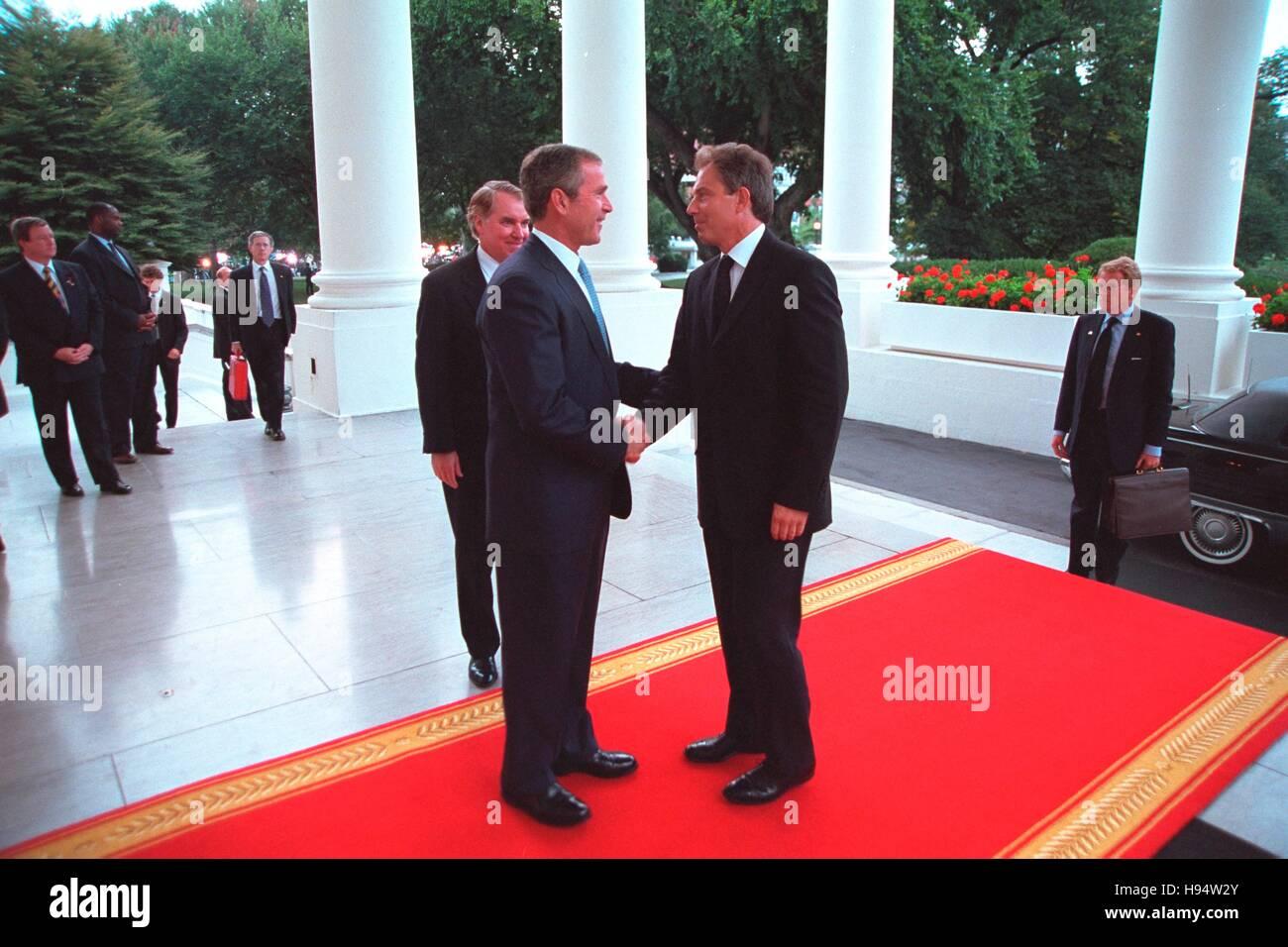 U.S. President George W. Bush greets British Prime Minister Tony Blair at the White House North Portico entrance - Stock Image