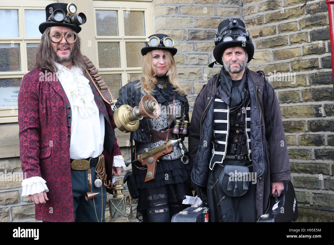 Haworth, UK. 19th Nov, 2016. Three steampunks stood next to a wall in Haworth, 19th November 2016. Credit:  Barbara Stock Photo