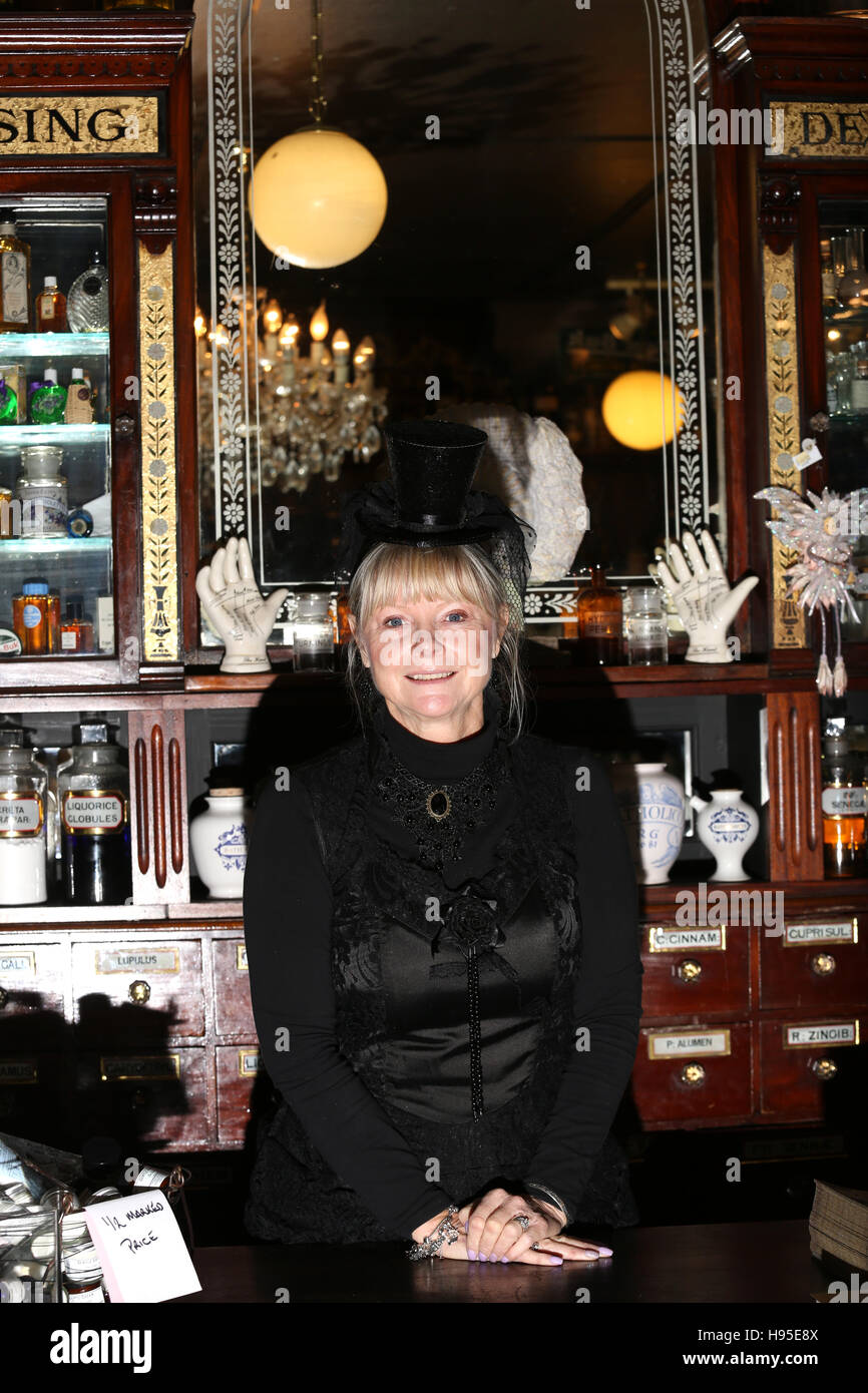 Haworth, UK. 19th Nov, 2016. A women dressed in black inside the apothecary, Haworth, 19th November 2016. Credit: Stock Photo