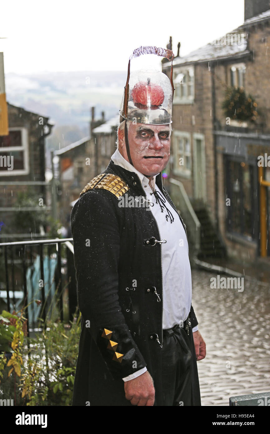 Haworth, UK. 19th Nov, 2016. A man in a costume with brains on top of his head, Haworth, 19th November 2016. Credit: Stock Photo