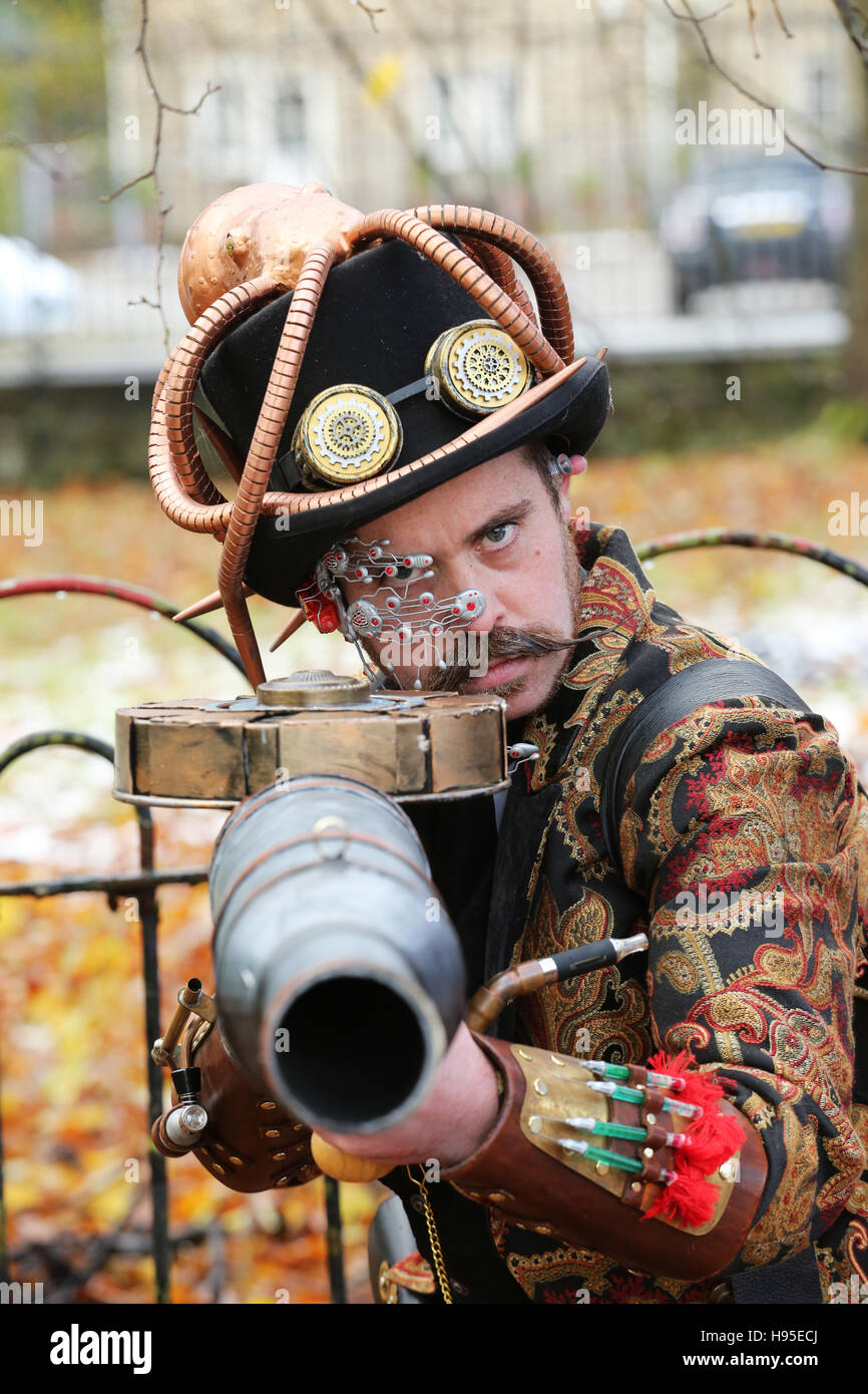 Haworth, UK. 19th Nov, 2016. A Steampunk clothed man pointing a gun towards the photographer, Haworth, 19th November Stock Photo