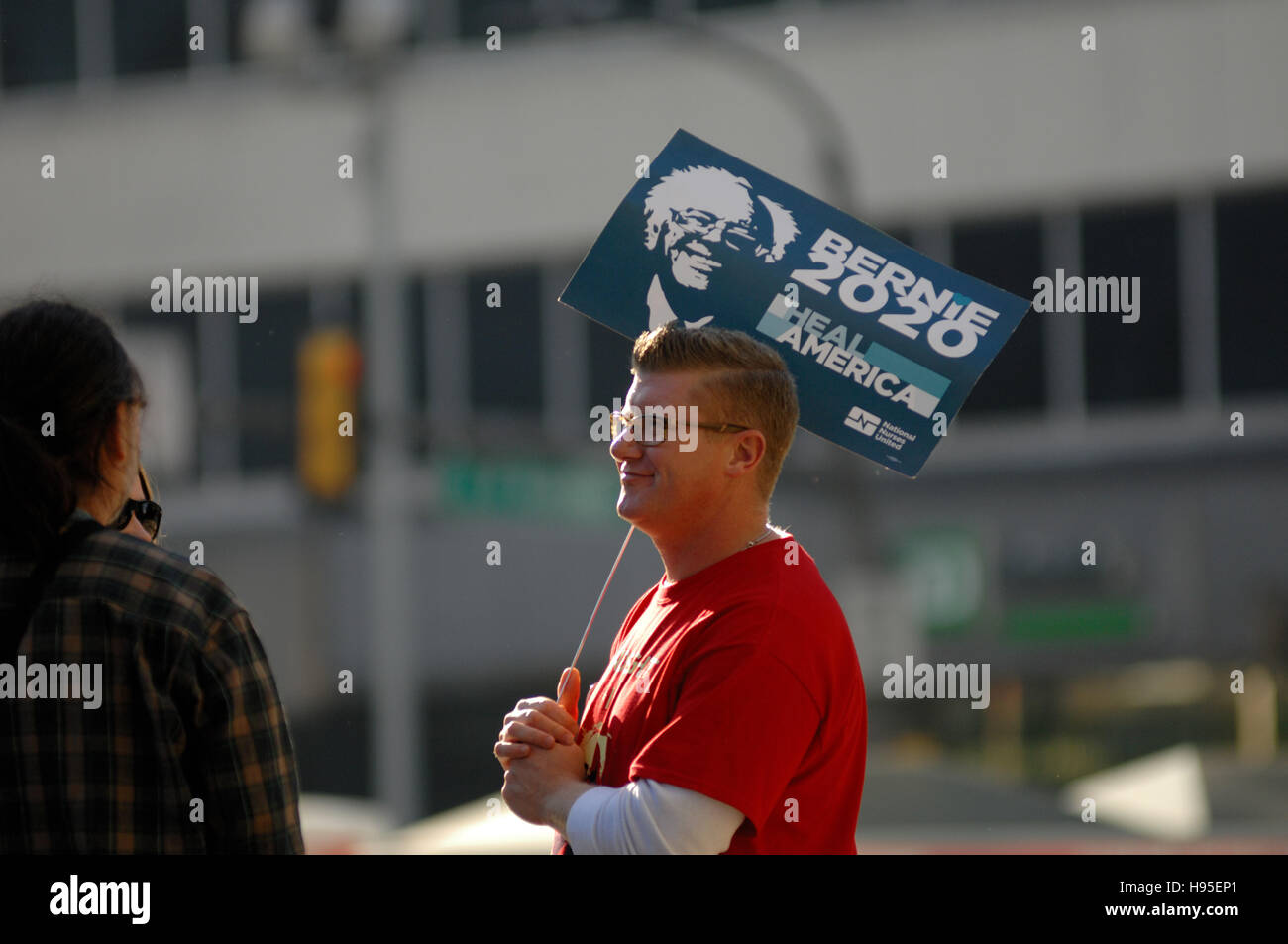 Philadelphia, Pennsylvania, USA. 19th November, 2016. Protester is seen holding a sign in  support of Bernie Sanders - Stock Image
