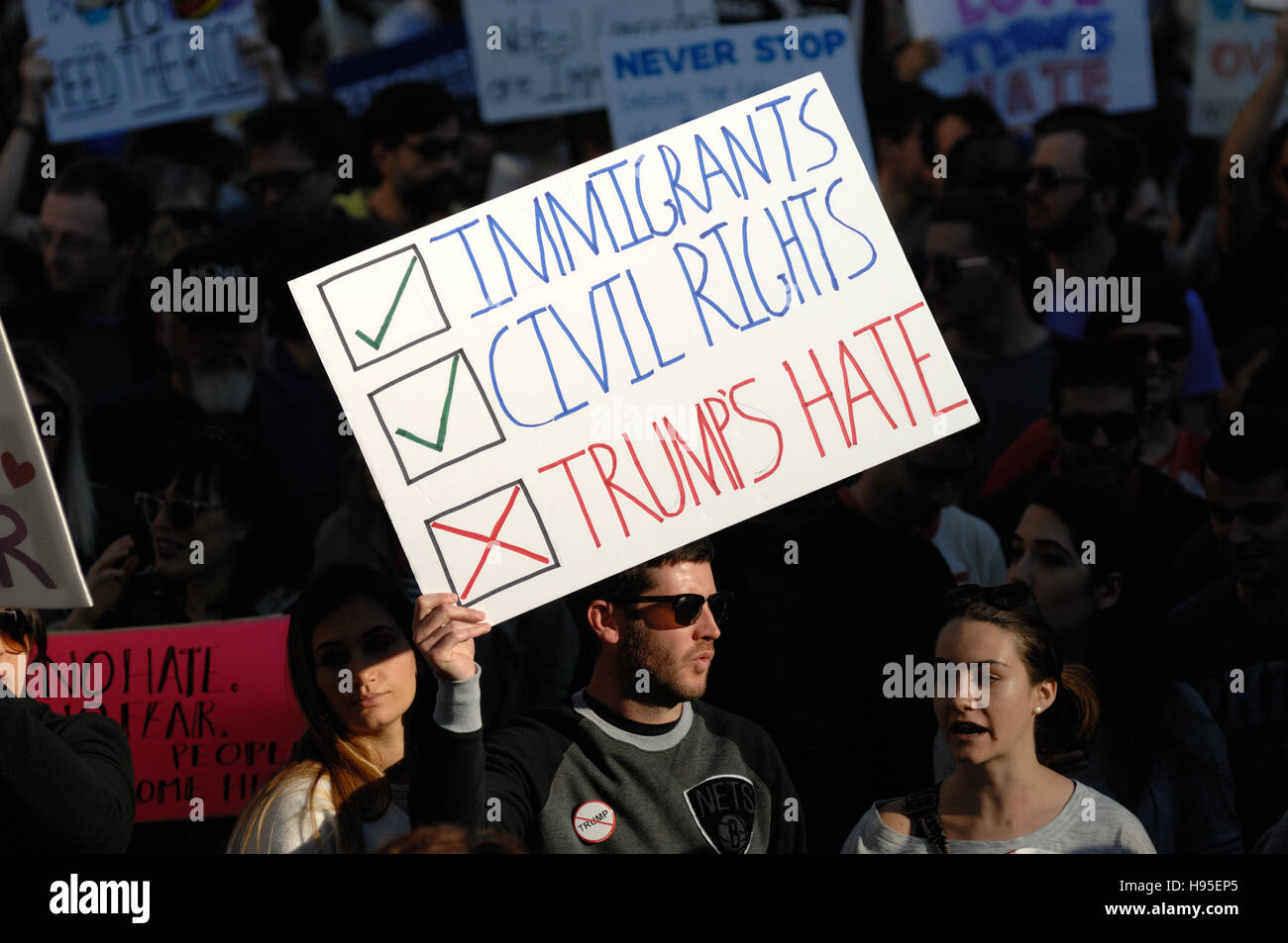 Philadelphia, Pennsylvania, USA. 19th November, 2016. Protesters carry signs during ongoing Anti-Trump protests, - Stock Image