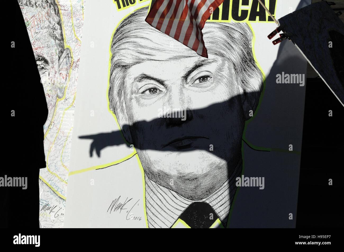 Philadelphia, Pennsylvania, USA. 19th November, 2016. Artist Mark G displays artworks he produced of Barack Obama, - Stock Image