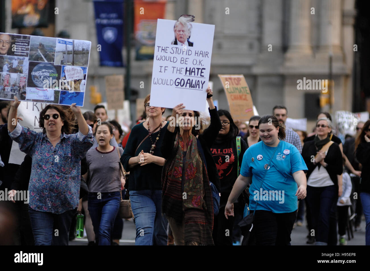 Philadelphia, Pennsylvania, USA. 19th November, 2016. Protesters carry signs as they march on Market St. during - Stock Image
