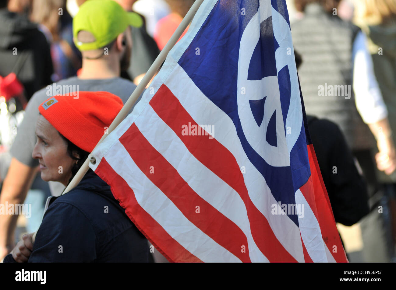 Philadelphia, Pennsylvania, USA. 19th November, 2016. Protesters carry signs and flags as they march on Market St. - Stock Image