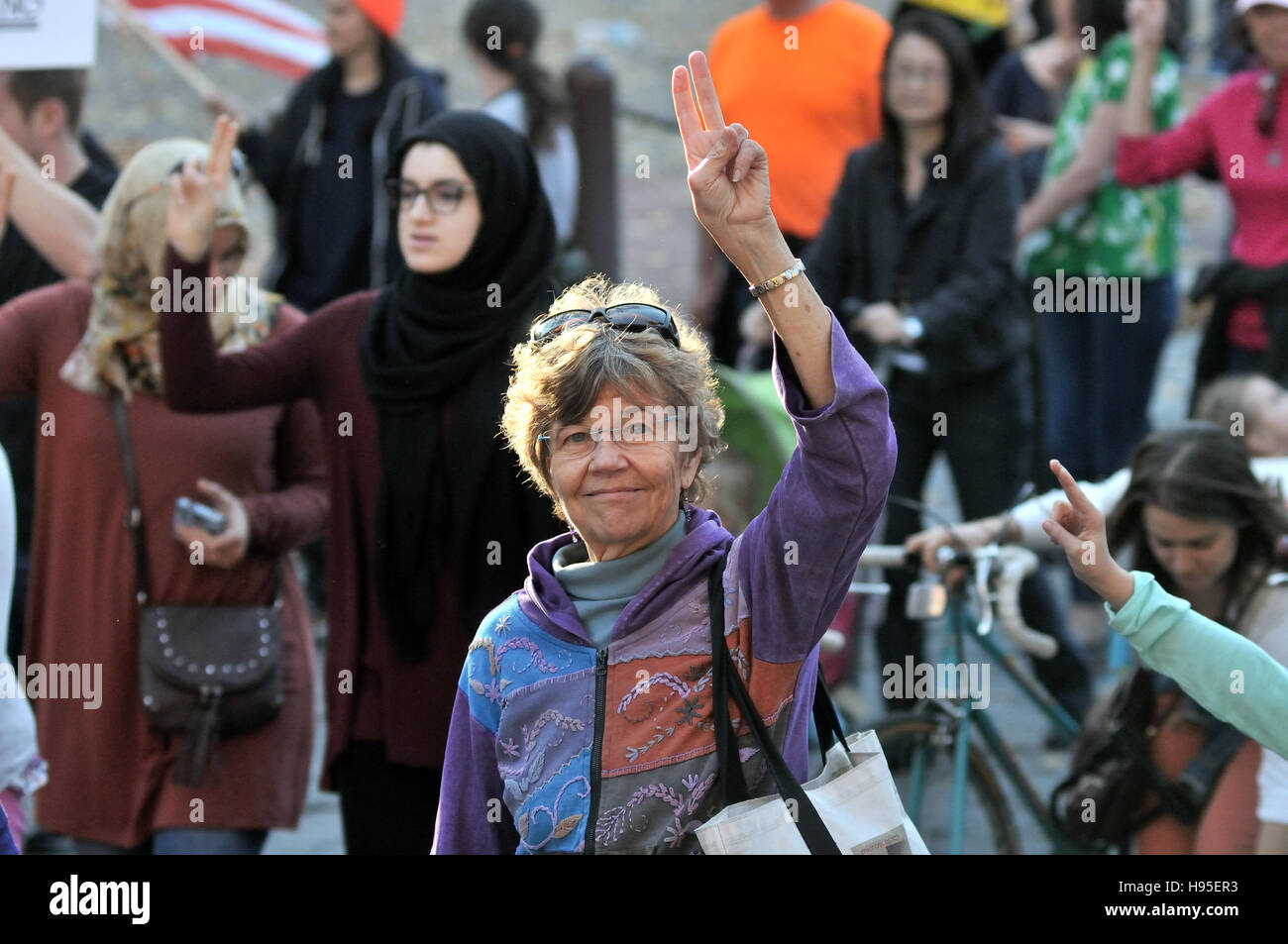 Philadelphia, Pennsylvania, USA. 19th November, 2016. Protesters make peace-signs as they march past Independence - Stock Image