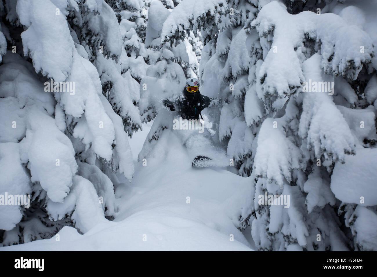 Snowboarding the powder on the ski resort of Saint Gervais Les Bains - Stock Image
