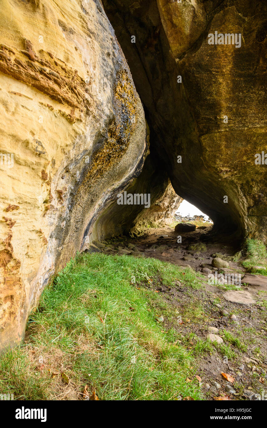Caves near Blackwaterfoot, Isle of Arran, North Ayrshire, Scotland - Stock Image