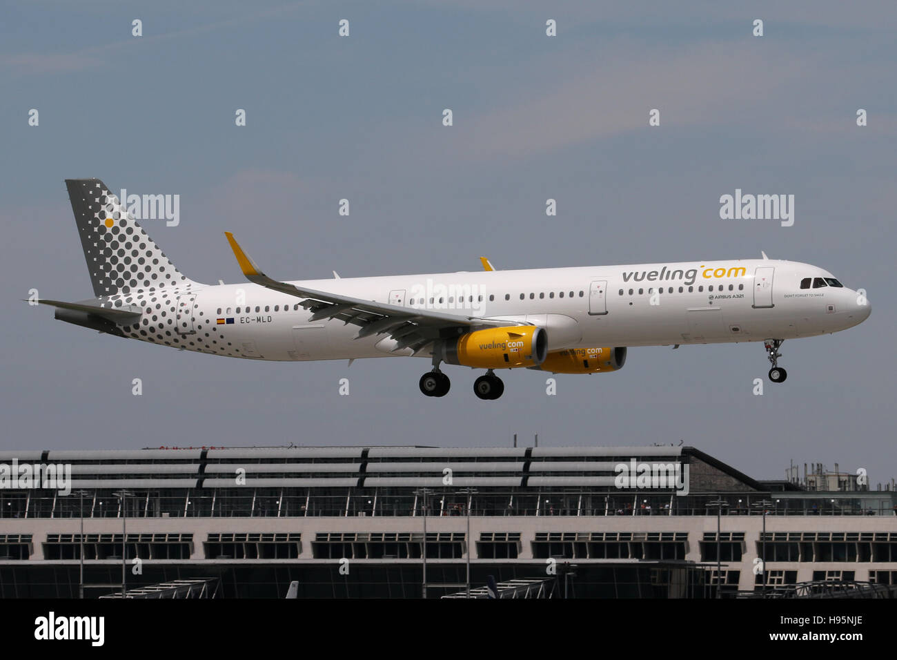 Stuttgart, Germany – May 22, 2016: Vueling, Airbus A321 is landing at Stuttgart Airport - Stock Image