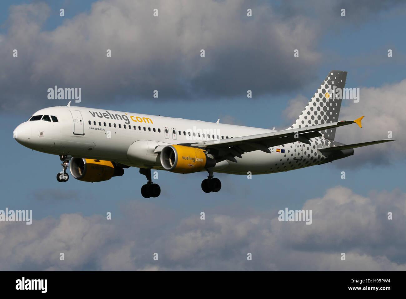 Zurich, Switzerland - July 29, 2016: Vueling, Airbus A320 is landing at Zurich Airport - Stock Image