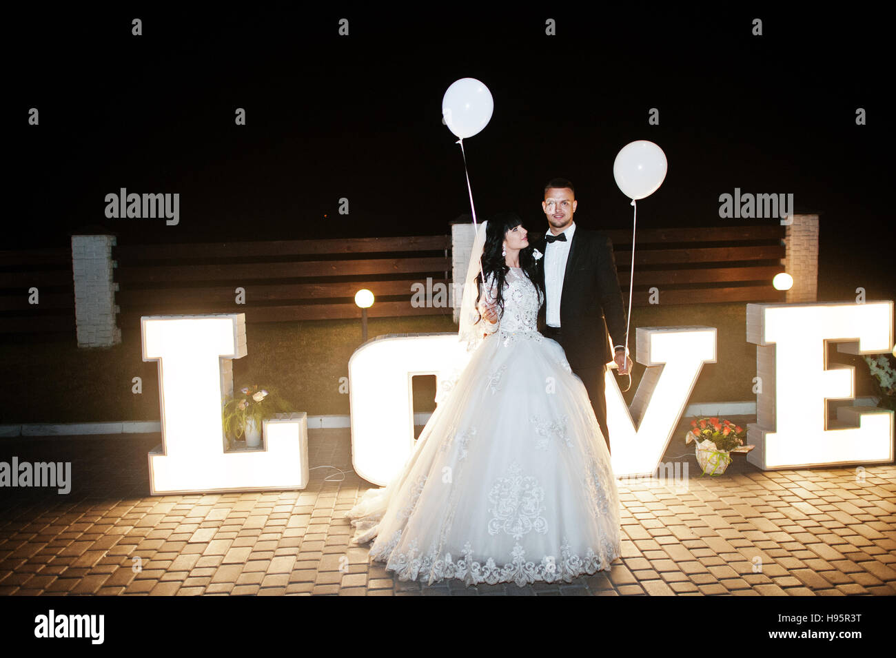 Stylish Wedding Couple With Lights Balloons Stay Near Great Big