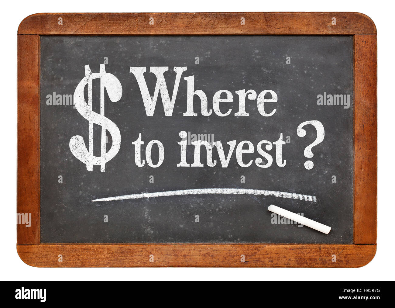 Where to invest question  - white chalk text on a vintage slate blackboard - Stock Image