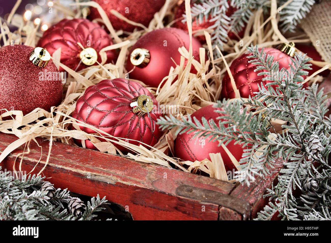 Glass Christmas ornaments packed in an old antique wooden box with ...