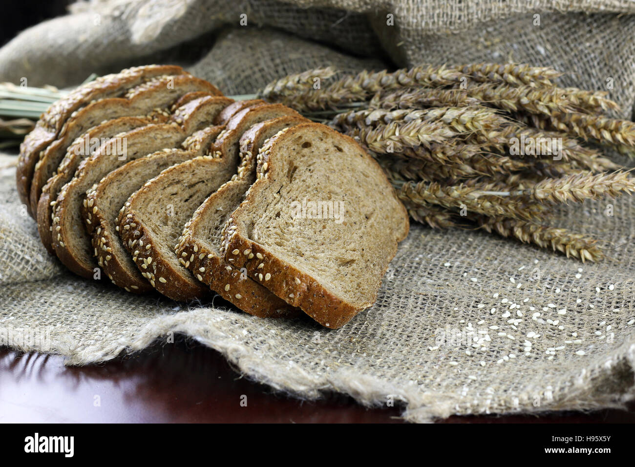 rye bread and ears on the table - Stock Image