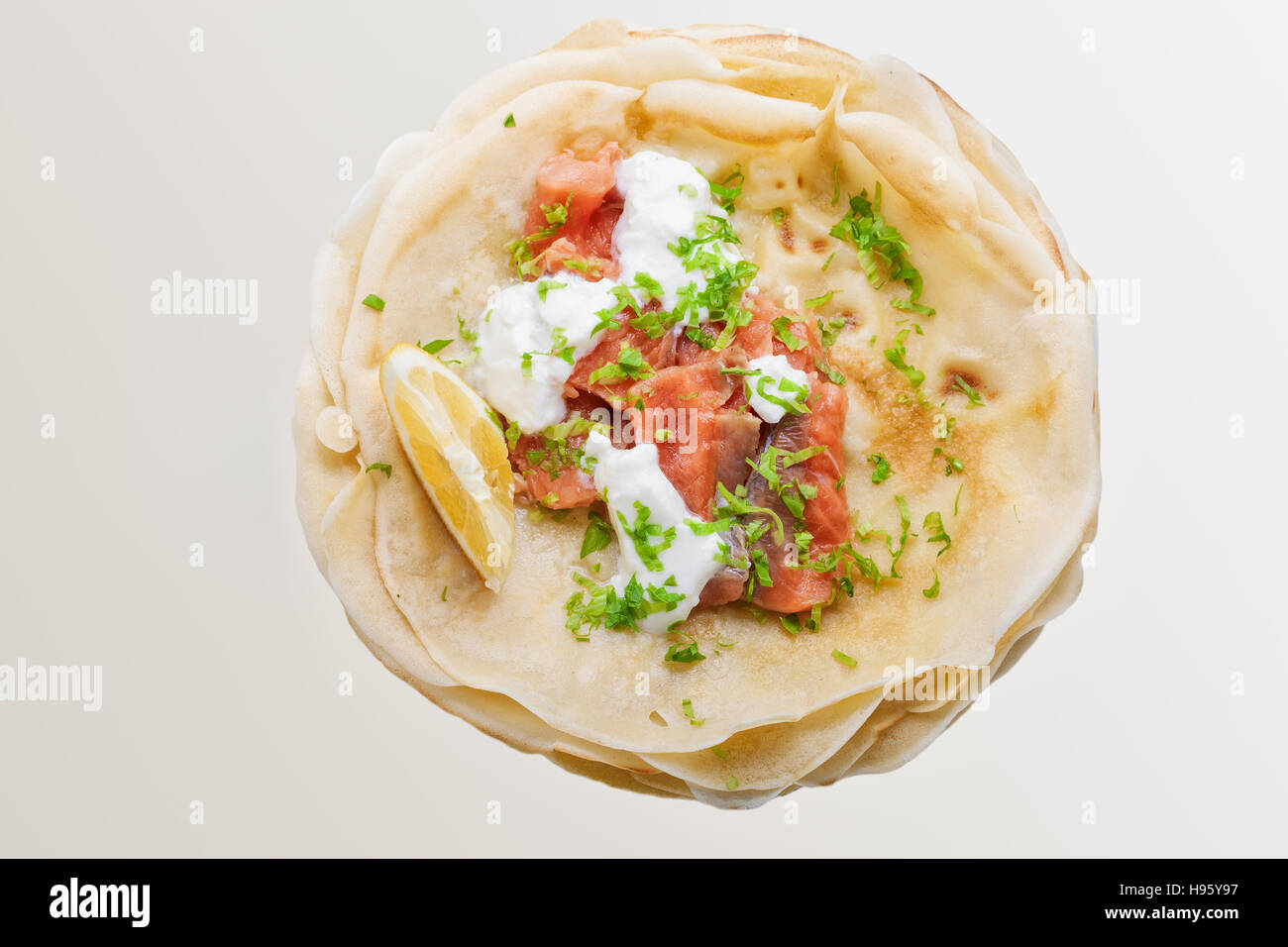 Crispy crepes with smoked salmon  and  cream cheese. - Stock Image