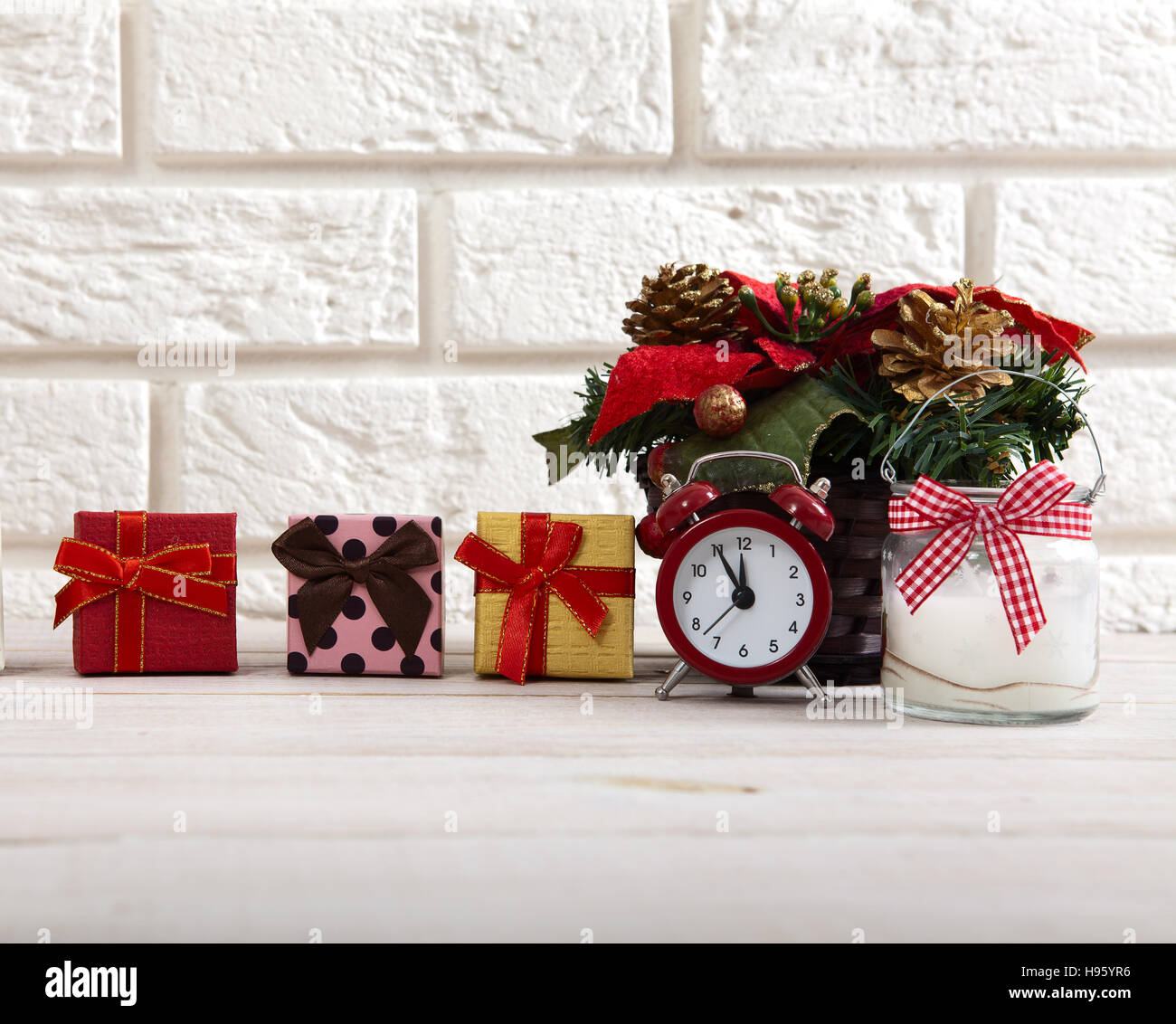 christmas decorations christmas background watch the candle and christmas tree on a wooden table next to white wall