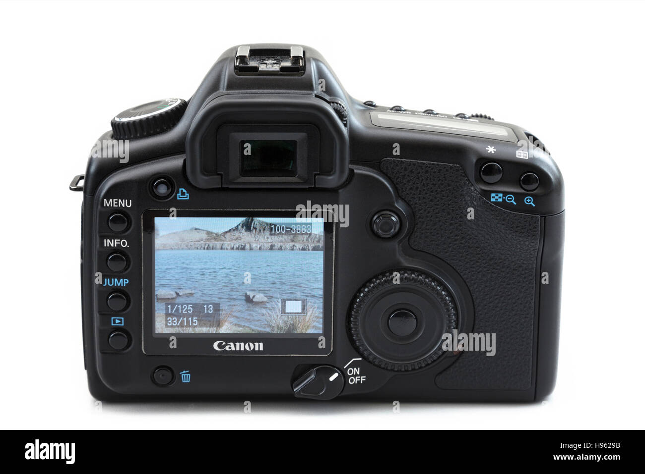 LCD screen on back of a Canon 5D mk II digital SLR camera showing a photograph of a coastal outdoor scene. Isolated - Stock Image