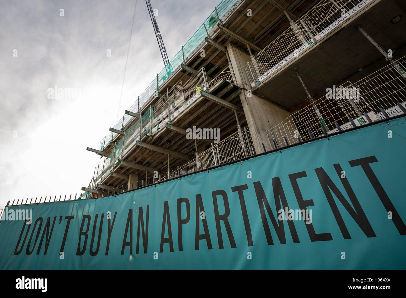 'Don't Buy An Apartment' banner seen near private flats currently under construction in south east London, - Stock Image