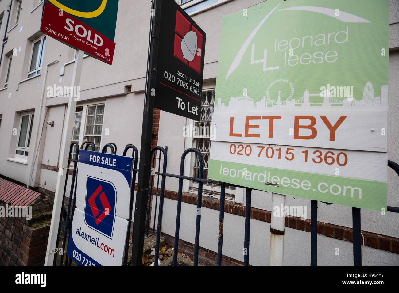 Estate agents boards advertising property sale or rental in London, UK. Stock Photo