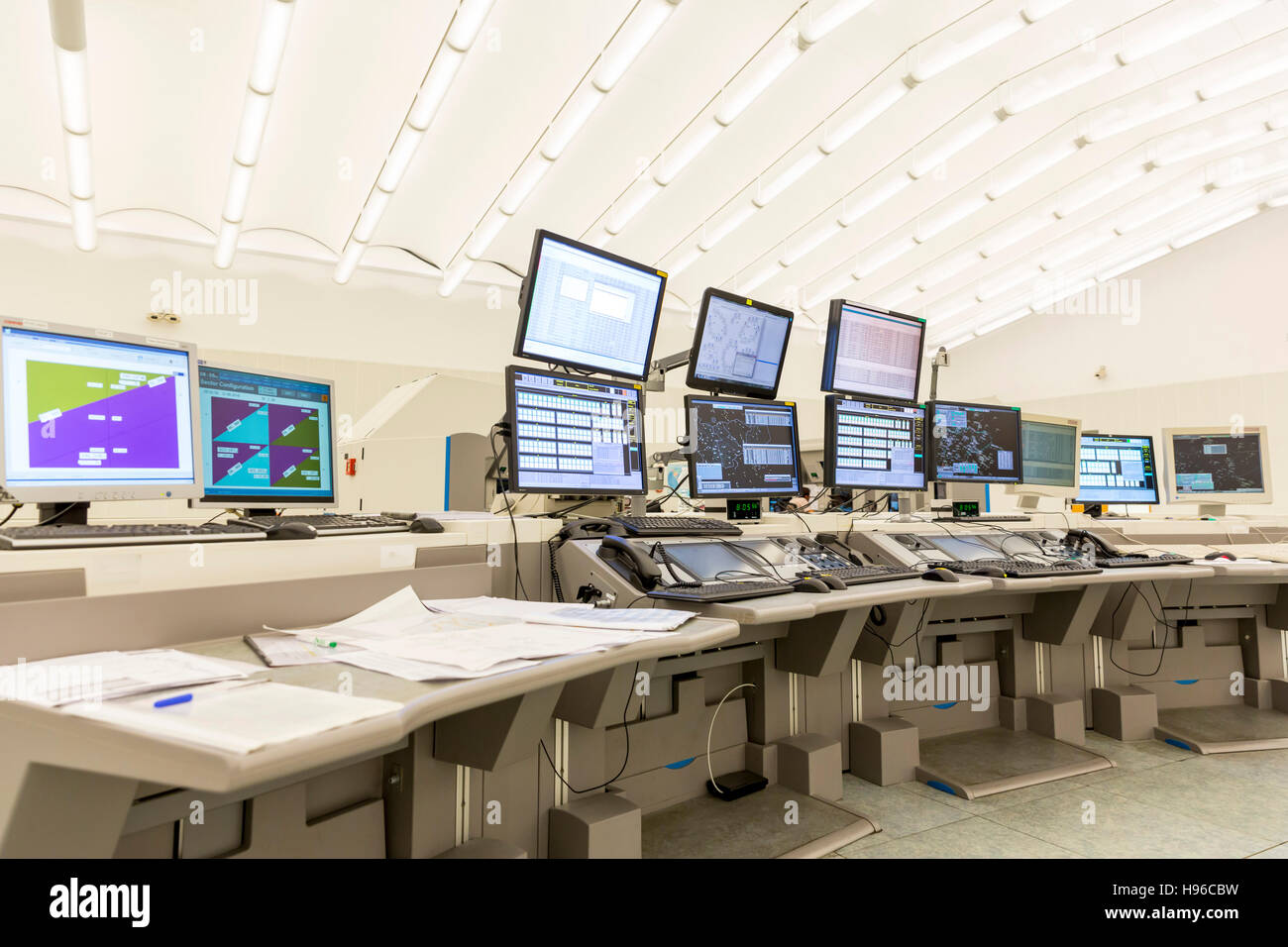 Sofia, Bulgaria - September 12, 2016: Air traffic control monitors at work in the flight control tower at Sofia's - Stock Image