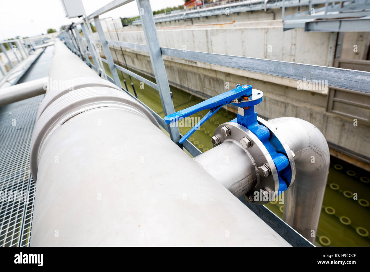 Water treatment plant piping system. Modern urban wastewater treatment plant. Water purification is the process - Stock Image