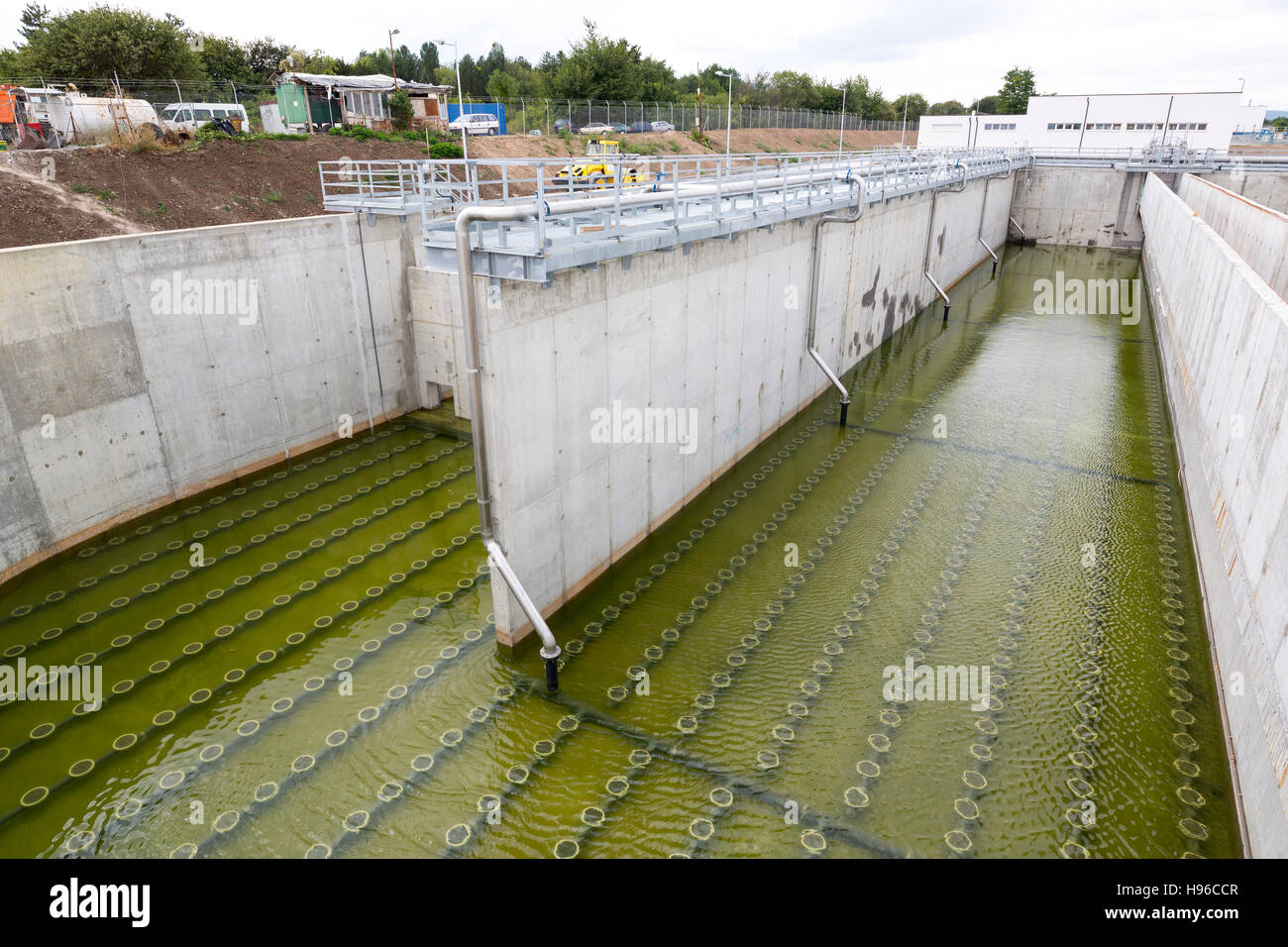 Modern urban wastewater treatment plant. Water cleaning facility outdoors. Water purification is the process of - Stock Image